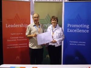 CMEA/ACME President Ed Wasiak congratulates Jean McKen